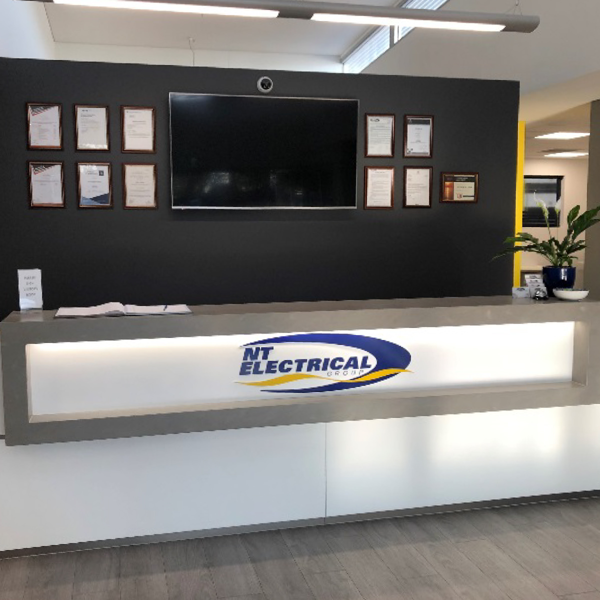Northern Territory Electrical Group - Front reception area with desk and awards.