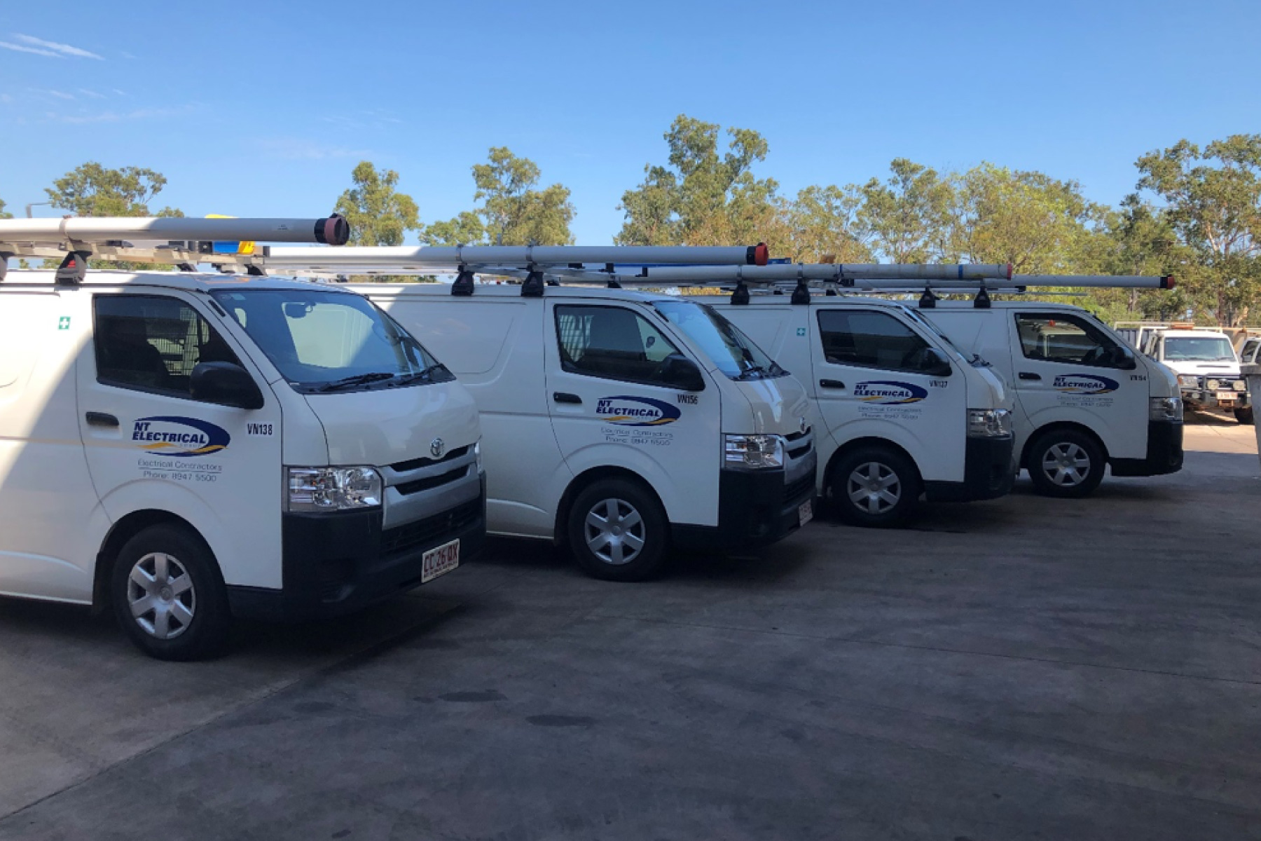 Northern Territory Electrical Group - Electrical Technician vans parked side by side.